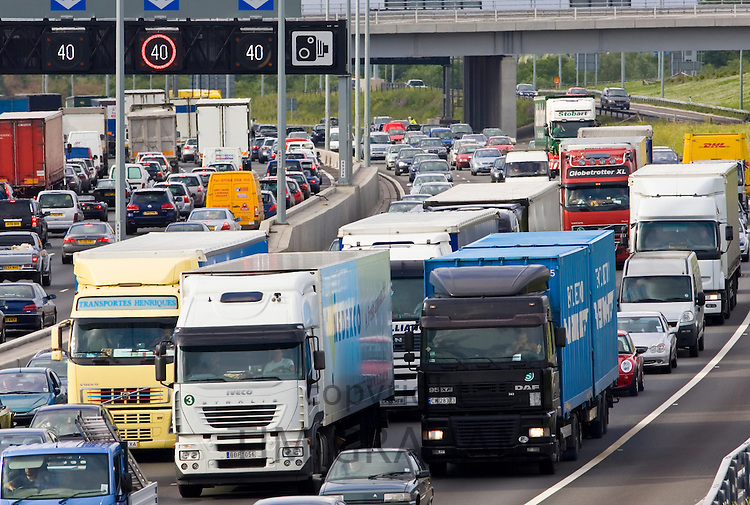 Traffic congestion of cars and trucks at a standstill in both directions on the M25 motorway, London, United Kingdom