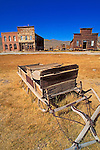Wooden sleigh and store fronts on Main Street, Bodie State Historic Park (National Historic Landmark), California USA