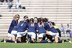 20 October 2013: Virginia's starters huddle on the field before the game. The University of North Carolina Tar Heels hosted the University of Virginia Cavaliers at Fetzer Field in Chapel Hill, NC in a 2013 NCAA Division I Women's Soccer match. Virginia won the game 2-0.