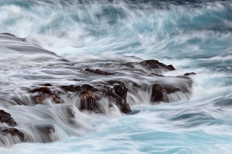 Waves and volcanic rock along the Puna Coast on the Big Island of Hawaii, USA