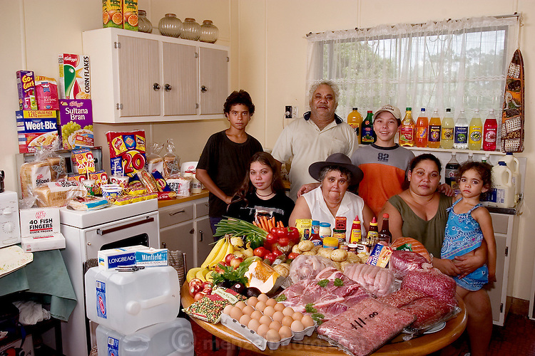 "(MODEL RELEASED IMAGE). The Brown family of Riverview, Australia with a week's worth of food: Doug Brown, 54, and his wife Marge, 52, with their daughter Vanessa, 32, and her children, Rhy, 12, Kayla, 15, John, 13, and Sinead, 5. The length of the Brown's grocery list changes depending on whether Vanessa and her children are living with them at the moment. Cooking methods: electric stove, microwave, and BBQ. Food preservation: refrigerator-freezer. Favorite foods- Doug: ""Anything anyone else cooks."" Marge: yogurt. Sinead: Mackas (McDonald's).  /// The Brown family is one of the thirty families featured in the book Hungry Planet: What the World Eats (p. 22). Food expenditure for one week: $376.45 USD. (Please refer to Hungry Planet book p. 23 for the family's detailed food list.)."