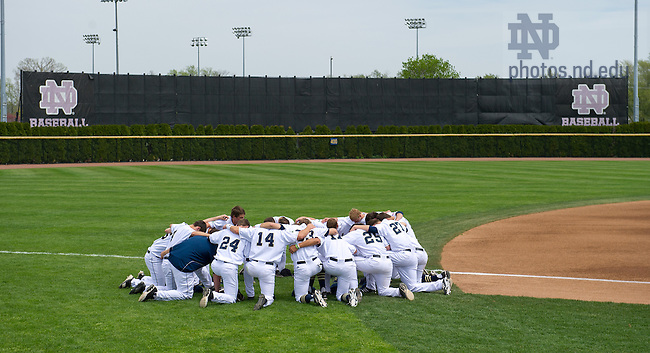 May 4, 2013; Baseball players kneel in prayer before a game...Photo by Matt Cashore/Univeristy of Notre Dame