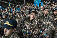 Army cadets look on as FC Astana play against Greek side Olympiacos in the group stage of the Europa League, in the Astana Arena. Army cadets have their own section in the stadium where they help generate noise in support of the team.