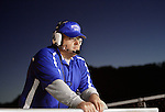 """Assistant Coach Jon Collins watches the game from outside the coach's box in the stands at Breathitt County High School on Friday Oct. 14, 2011. """"I mainly coach them on the ride home,"""" Collins said about his two sons, senior Will Thomas and sophomore Jon Keith. Photo by Rachel Aretakis"""