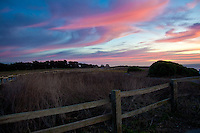 A wooden fence at sunset - Bluff Top Coastal Park, Half Moon Bay, California.