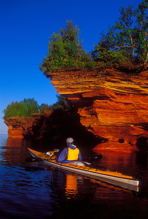 A sea kayaker explores the sea caves on Devils Island in the Apostle Islands National Lakeshore near Bayfield, Wis.