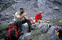 CANADA, ALBERTA, KANANASKIS, MAY 2002. A hiker shares lunch with a park ranger at Tombstone Lake.  The Kananaskis Country provincial park is home to Canada's most beautiful nature and wildlife. It has also escaped the mass tourism as in Banff National Park. Photo by Frits Meyst/Adventure4ever.com