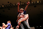 "Mason, 7, sings to ""Break your Heart"" during the talent show at DanceBlue on March 3, 2012 in Memorial Coliseum."