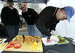 A cook places his seasoned sausage patties that be judged in the Pikes Place Market's Annual Barbecue and Chili Competition.  For over a century a century, the Pike Place Market, has become a city institution and a national attraction, bringing in over a million tourists a year. .Jim Bryant Photo. ©2010. ALL RIGHTS RESERVED.