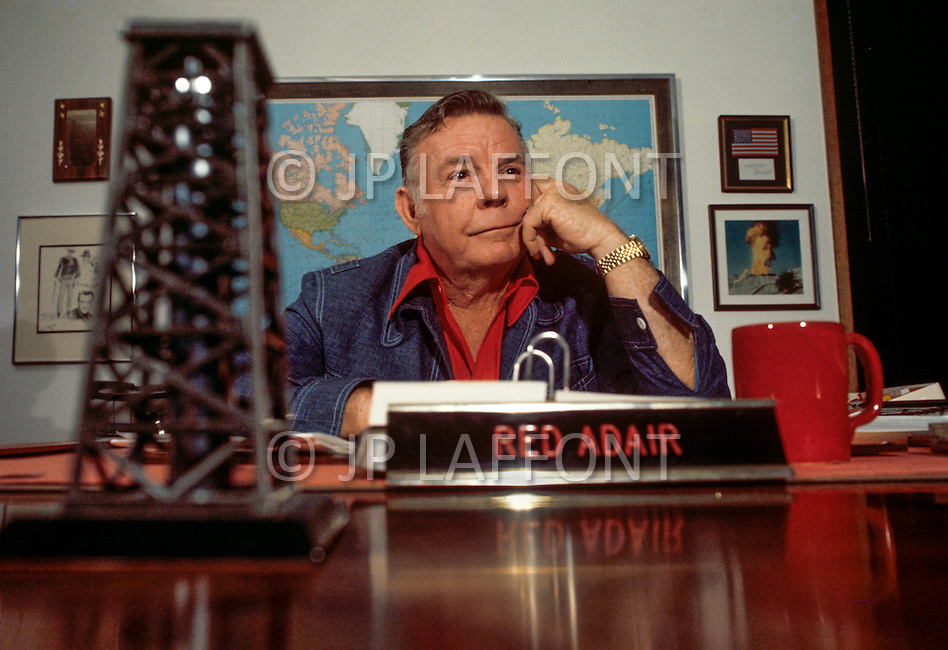 Houston, Texas - May 6, 1977. Red Adair at the office of Red Adair Co. Red Adair (June 18, 1915 - August 7, 2004) was an American oil well firefighter, who later became an innovator in the highly specialized profession of extinguishing and capping blazing, or erupting oil well blowouts, both on land and offshore.