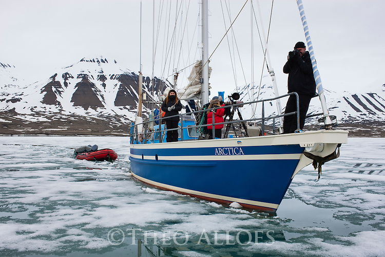 """Norway, Svalbard, boat Arctica as it pushes into a fjord covered with """"fast ice"""""""