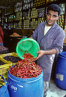 Tunisia.  Tunis Medina.  Pepper Vendor with Red Peppers.
