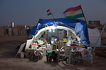 DOMIZ, IRAQ: A makeshift store in the Domiz refugee camp flies the Kurdish flag...Over 7,000 Syrian Kurds have fled the violence in Syria and are living in the Domiz refugee camp in the semi-autonomous region of Iraqi Kurdistan...Photo by Ali Arkady/Metrography