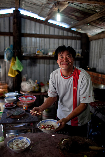 Dao Van Dan, 38, owner of the Orchid Restaurant, cooks for tourists on Con Son Island, part of the Con Dao Islands.The 16 mountainous islands and islets are situated about 143 miles southeast of Ho Chi Minh City in Vietnam, in the South China. Photo taken Thursday, May 6, 2010...Kevin German / LUCEO For the New York Times