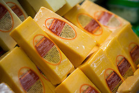 Packages of NYS Cheddar Cheese are seen in a supermarket in New York on Tuesday, February 25, 2014. U.S. producer prices rose in January 2014, spurred on by higher food prices which jumped 1 percent. (© Richard B. Levine)