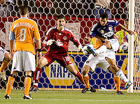 Houston Dynamo goalkeeper Pat Onstad (18) defends his goal mouth from advancing CD Chivas USA defender Jonathan Bornstein (13) battle. The Houston Dynamo defeated CD Chivas USA 2-0 at Home Depot Center stadium in Carson, California on Saturday May 8, 2010.  .