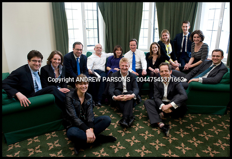 David and Samantha Cameron Pose for a photo with David's team in his office in Norman Shaw South, Tuesday May 11, 2010, Photo By Andrew Parsons