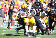 College Park, MD - October 15, 2016: Minnesota Golden Gophers wide receiver Melvin Holland Jr. (5) is tackled by several Maryland Terrapins defenders during game between Minnesota and Maryland at  Capital One Field at Maryland Stadium in College Park, MD.  (Photo by Elliott Brown/Media Images International)