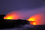 Lava flow entering the Pacific Ocean at dusk, Hawaii Volcanoes National Park, The Big Island, Hawaii USA