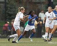 Duke University midfielder Toni Payne (10) dribbles as Boston College midfielder Kate McCarthy (21) defends.Boston College (white) defeated Duke University (blue/white), 4-1, at Newton Campus Field, on October 6, 2013.