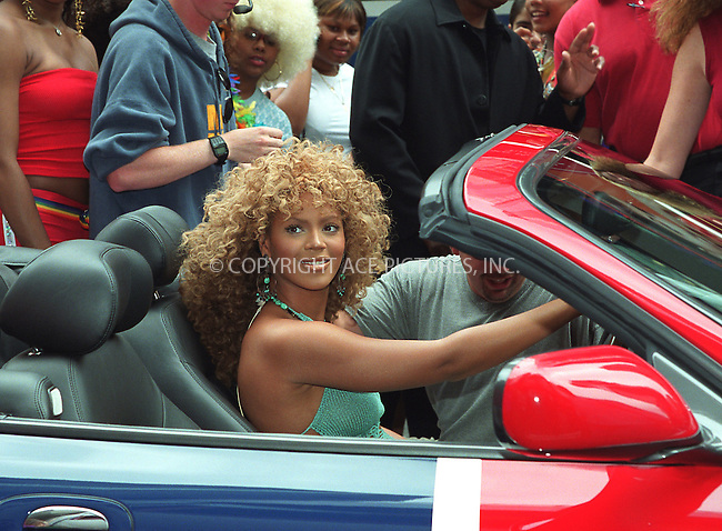 """Mike Myers and Beyonce Knowles participate in the taping for MTV's popular show, """"Total Request Live"""" in Times Square, New York. They arrive at MTV Studios in """"Shaguar,"""" a British flag-painted Jaguar which was featured in """"Goldmember."""" July 26, 2002. Please byline: Alecsey Boldeskul/NY Photo Press.   ..*PAY-PER-USE*      ....NY Photo Press:  ..phone (646) 267-6913;   ..e-mail: info@nyphotopress.com"""