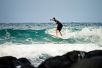 A surfer races a section on a small day at Burleigh Heads - Beach & surf lifestyle photos - Gold Coast, Australia