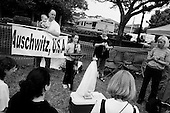 Pinellas Park, Florida.USA.March 24, 2005..Protesters pray for the help of Governor Jeb Bush, Republican-Florida, to step in and save the life of Terri Schiavo outside the Woodside Hospice where Schiavo is a patient. The press covers the event in forces with live broadcasts and satellite feeds...The U.S. Supreme Court rejected a plea from the parents of Terri Schiavo to restart her feeding, leaving them nearly out of options and time in the seven-year legal fight for their brain-damaged daughter's life.