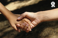 Close-up of mother holding son's hand (Licence this image exclusively with Getty: http://www.gettyimages.com/detail/sb10065145bx-001 )