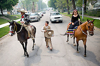 Ezequiel Vazquez, left, Sergio Vazquez, 13, center, and Alina Vazquez, 8, right, ride horses near S. 23rd St. and I St. following the Cinco de Mayo Omaha Parade on Saturday, May 7, 2016 in Omaha. Dancers, organizations, politicians and other groups marched down 24th St. in South Omaha, Neb.
