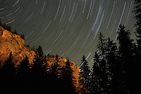 Star tracks on Sky and rock formation, Cheile Bicazului-Hasmas National Park, Carpathians, Transylvania, Romania,