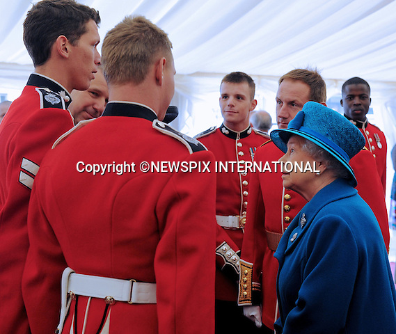 """QUEEN ELIZABETH.The Colonel in Chief, presents the new colours to The 1st Battalion Grenadier Guards, Buckingham Palace London..Photo Credit: ©Harmer_Newspix International..**ALL FEES PAYABLE TO: """"NEWSPIX INTERNATIONAL""""**..PHOTO CREDIT MANDATORY!!: NEWSPIX INTERNATIONAL..IMMEDIATE CONFIRMATION OF USAGE REQUIRED:.Newspix International, 31 Chinnery Hill, Bishop's Stortford, ENGLAND CM23 3PS.Tel:+441279 324672  ; Fax: +441279656877.Mobile:  0777568 1153.e-mail: info@newspixinternational.co.uk"""