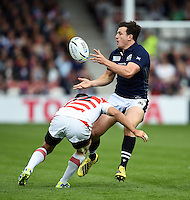 Matt Scott of Scotland passes the ball. Rugby World Cup Pool B match between Scotland and Japan on September 23, 2015 at Kingsholm Stadium in Gloucester, England. Photo by: Patrick Khachfe / Onside Images