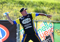 Jul 26, 2015; Morrison, CO, USA; NHRA pro stock driver Allen Johnson reacts as he throws a water bottle after losing in the final round of the Mile High Nationals at Bandimere Speedway. Mandatory Credit: Mark J. Rebilas-USA TODAY Sports