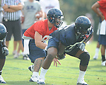 Quaterback Jeremiah Masoli (8) takes a snap as the University of Mississippi began football practice on Sunday, August 8, 2010.