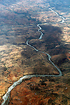 Africa, Kenya. River cuts through the wild landscape of Kenya.