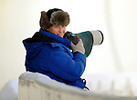 15 December 2007: Photographer Jennifer Wenzel looks over her shoulder at the FIBT World Cup Bobsled Competition at the Olympic Sports Complex on Mount Van Hoevenberg, at Lake Placid, New York, USA. ..Mandatory Photo Credit: Ed Wolfstein Photo