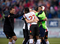 Zack Steffen (99) of Maryland celebrates with teammates after the ACC Finals at the Maryland SoccerPlex in Boyds, MD.  Maryland defeated Virginia, 1-0, to win the title.