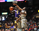 "LSU's Johnny O'Bryant III (2) grabs a rebound over Ole Miss' Jarvis Summers (32) and Ole Miss' Reginald Buckner (23) at the C.M. ""Tad"" Smith Coliseum in Oxford, Miss. on Saturday, February 25, 2012. (AP Photo/Oxford Eagle, Bruce Newman).."