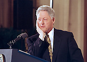 Washington, DC - February 16, 2000 -- U.S. President Bill Clinton listens to a reporter's question during his press conference in the East Room of the White House on 16 February, 2000.<br /> Credit: Arnie Sachs / CNP