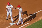 6 April 2015: Washington Nationals outfielder Michael Taylor get a fist bump from first base coach Tony Tarasco after a leading off single in the first inning of the Home Opening Game against the New York Mets at Nationals Park in Washington, DC. The Mets rallied to defeat the Nationals 3-1 in their first meeting of the 2015 MLB season. Mandatory Credit: Ed Wolfstein Photo *** RAW (NEF) Image File Available ***
