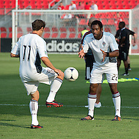 18 July 2012: Colorado Rapids midfielder Brian Mullan #11 and Colorado Rapids defender Marvell Wynne #22 take warm-up during an MLS game between the Colorado Rapids and Toronto FC at BMO Field in Toronto, Ontario..Toronto FC won 2-1..