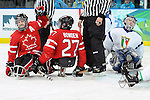 Greg Westlake celebrates his goal with Brad Bowden, which gave Canada a 2-0 lead in preliminary action at UBC Thunderbird Arena during the Paralympic Games in Vancouver.