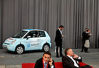"Electric car and business people at trade fair. Renewable sources will be helping to meet the world's demand for energy in the future. This development opens new markets and opportunities for business. Hoping to make ""green business"" and ""green profit"" over 60 exhibitors took part in the The North European Renewable Energy Convention (Nerec) , in Norway, presenting their solutions for renewable energy in the future. .© Fredrik Naumann/Felix Features"