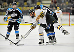 30 October 2010: University of Vermont Catamount forward Wahsontiio Stacey, a Senior from Kahnawake, Quebec, manages to get a shot away against the University of Maine Black Bears at Gutterson Fieldhouse in Burlington, Vermont. The Black Bears defeated the Catamounts 3-2 in sudden death overtime. Mandatory Credit: Ed Wolfstein Photo