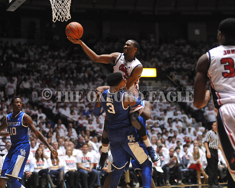 Ole Miss' Jarvis Summers (32) charges into Kentucky's Nerlens Noel (3) at the C.M. &quot;Tad&quot; Smith Coliseum on Tuesday, January 29, 2013. Kentucky won 87-74...
