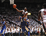 "Ole Miss' Jarvis Summers (32) charges into Kentucky's Nerlens Noel (3) at the C.M. ""Tad"" Smith Coliseum on Tuesday, January 29, 2013. Kentucky won 87-74..."