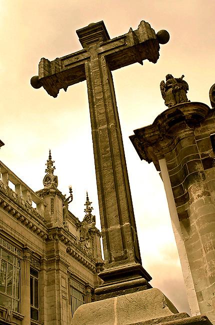 In front of the 17th century La Compania de Jesus Iglesia, stands one of the seven stone crosses stationed along Calle Garcia Moreno or the 'Street of the Seven Crosses' in Quito, Ecuador.