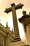 In front of the 17th century La Compania de Jesus Iglesia, stands one of the seven stone crosses stationed along Calle Garcia Moreno or the 'Street of the Seven Crosses' in Quito, Ecuador.