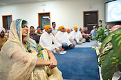 Sherry Dayal prays during the gathering at the Sikh Gurudwara of North Carolina in Durham to honor the victims of the Oak Creek shooting on Wednesday August 8th 2012.