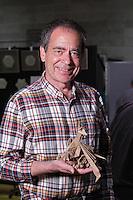 Origami designer and folder, Keith Nunas, Edmonton, Canada, with one of his dragon designs.